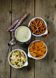 Different salted snacks and a glass of fresh beer Royalty Free Stock Photo