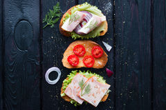 Different sandwiches with meat and vegetables Royalty Free Stock Image