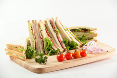 Different sandwiches on wooden desk Royalty Free Stock Photos