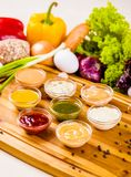 Different sauces assortment on wooden board stock image