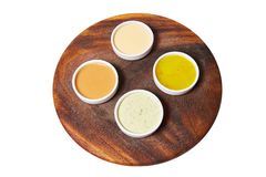 Different sauces ginger, spinach, mayonnaise, mustard, tomato stock image