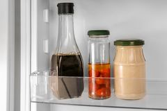 Different sauces on shel. F in fridge Royalty Free Stock Photos