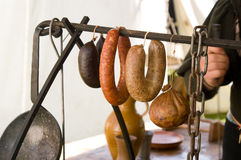Different sausages. On a meat hook of a butcher royalty free stock photo