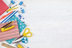 Different school stationery with space for design. On wooden background, flat lay stock image