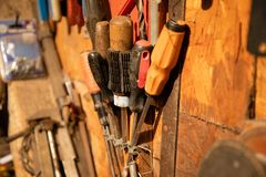 Different screwdrivers and other tools on garage stock images