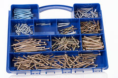Different Screws and other Parts sorted in a box. Different Screws and other Parts sorted in a plastic box Royalty Free Stock Photo