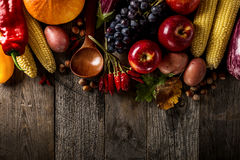 Different seasonal autumn vegetables and fruits on wooden background royalty free stock image