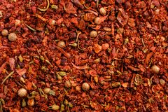 Different seasonings mixture of peppers peas, red pepper powder, background. Different seasonings mixture of peppers peas, sweet red pepper powder, background Stock Photos