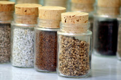 Different seed. In laboratory glass bottle Stock Photos