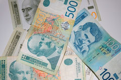 Different Serbian dinar bills scattered on white background. Different Serbian dinar bills scattered on white background royalty free stock image