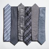 Different set of luxury tie on white Stock Photography