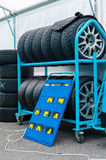 Different sets of racing tyres in a motorsport box Stock Image