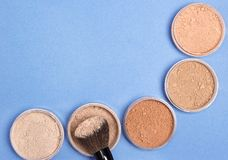 Different shades of loose cosmetic powder background Stock Photography