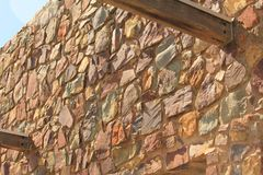 Rock wall in a winery. Different shades of rocks on the wall stock images