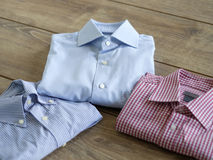 Different shirts on a wood table Stock Photography