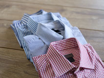 Different shirts wooden table casual Royalty Free Stock Photo