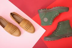 Different shoes on background. Different shoes on color background stock photos