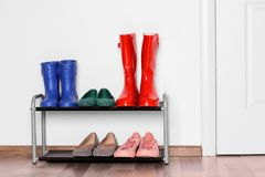 Different shoes. On shelf near wall royalty free stock photos