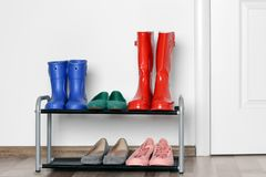 Different shoes. On shelf near wall royalty free stock images