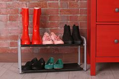 Different shoes. On shelf near wall stock photos