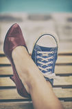 Different shoes. Woman legs in different shoes royalty free stock images