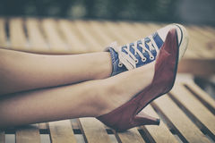 Different shoes. Woman legs in different shoes Royalty Free Stock Photography