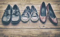 Different shoes. On a wooden table stock images