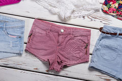 Different shorts on a wooden background. Royalty Free Stock Images