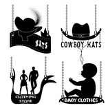 Different signboards of hats and clothes Royalty Free Stock Image