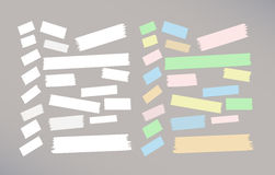 Different size colorful and white sticky paper, adhesive, masking tape stuck on gray background Stock Photo