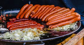 Sausages in a pan royalty free stock photography