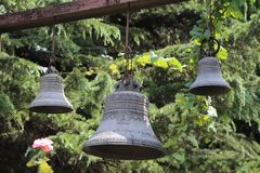 Different size metal bells for christian church royalty free stock photography