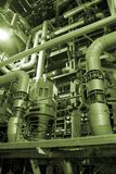 Different size pipes. An assortment of different size and shaped pipes at a power plant Royalty Free Stock Photo