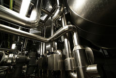 Different size and shaped pipes at a power plant Royalty Free Stock Image
