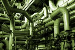 Different size and shaped pipes at a power plant Stock Photography