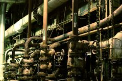 Different size and shaped pipes and valves Royalty Free Stock Photos