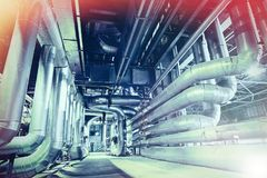 different size and shaped pipes and valves at factory Royalty Free Stock Photography