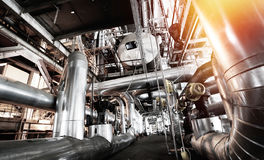 Different size and shaped pipes and valves at power plant Royalty Free Stock Photo
