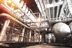 Different size and shaped pipes and valves at power plant Stock Photography