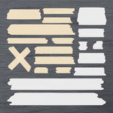 Different size sticky, adhesive tape, banners pieces are stuck on wooden background Royalty Free Stock Image