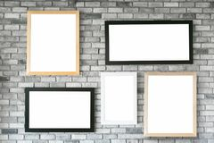 Different size and style empty photo frames on white concrete wa. Ll. with clipping path Stock Photo