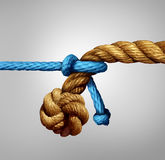 Different Sized Partnership. Concept as a thin blue cord pulling on a very thick rope as a metaphor for small and big business cooperation or unity with Stock Photography