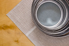 Different sized sieves Stock Photo