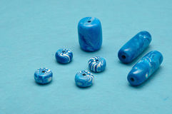 Different sizes of blue beads Stock Image