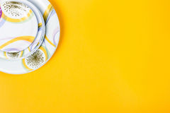 Different sizes empty plates, bright yellow background, copy space royalty free stock photography