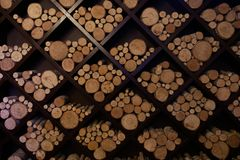 Different sizes of logs lie on a square shelves for the decoration. Of the restaurant Royalty Free Stock Photo