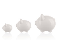 Different sizes of piggy banks. Saving money concept - Growing savings . Different sizes of piggy banks Royalty Free Stock Images