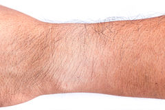 Different skin color on wrist under the watch Royalty Free Stock Photos