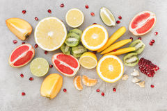 Different sliced juicy fruits stock photography