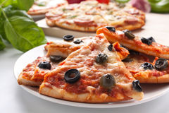 Different sliced pizzas with ingredients Royalty Free Stock Image